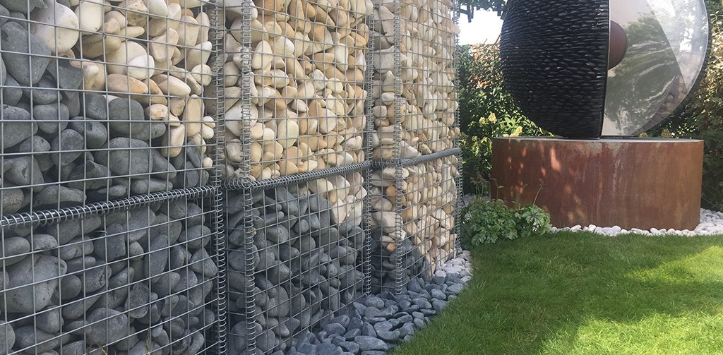 Top 5 garden ideas from harrogate, mental health awareness garden. Images of black and beige cobbles in square metal baskets.