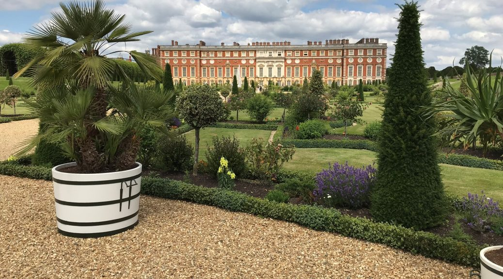 The Hampton Court Palace and it's Gardens. Golden gravel has been used to cover the ground.