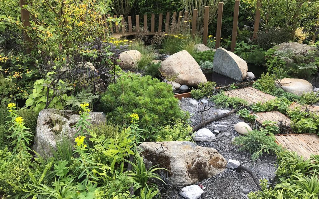 Through Your Eyes Garden featuring a selection of large boulders, rockery stone and cobbles all with brown/grey colour tones.