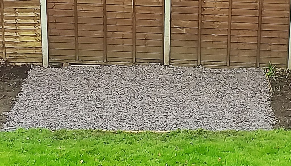 Slate laid down in the garden first before the table and chairs were installed.