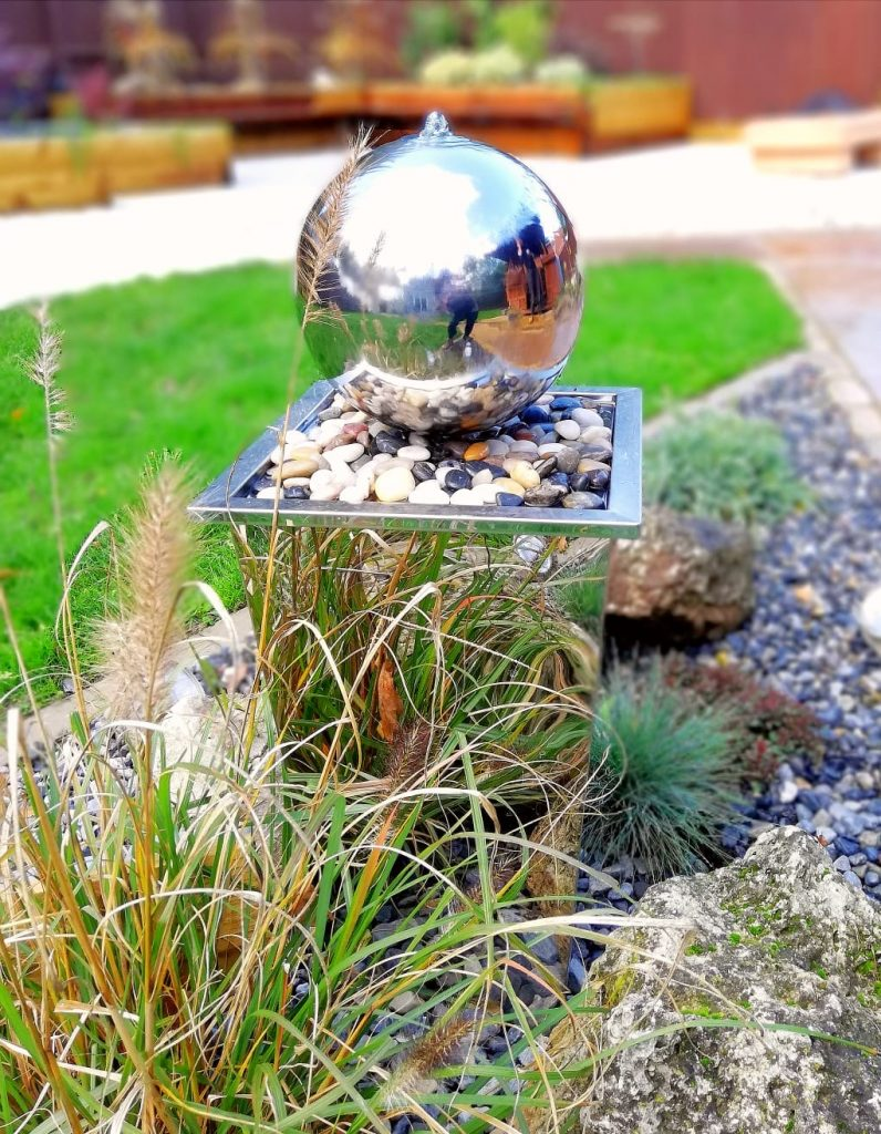 A small rounded water feature that has a reflective surface.