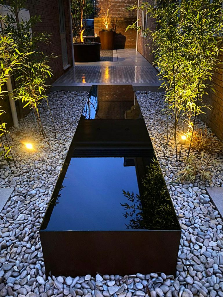 Water feature pool surrounded by our Duck Egg Pebbles