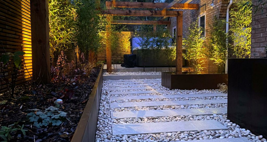 Back courtyard garden with our duck egg pebbles