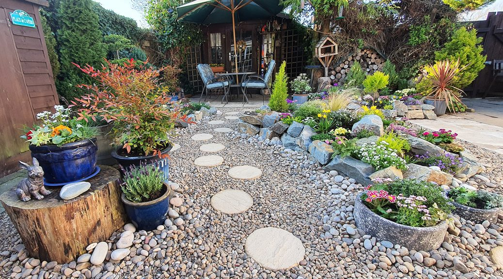 rockery garden with stepping stones and gravel
