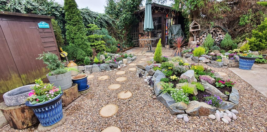 completed rockery garden with blue pots