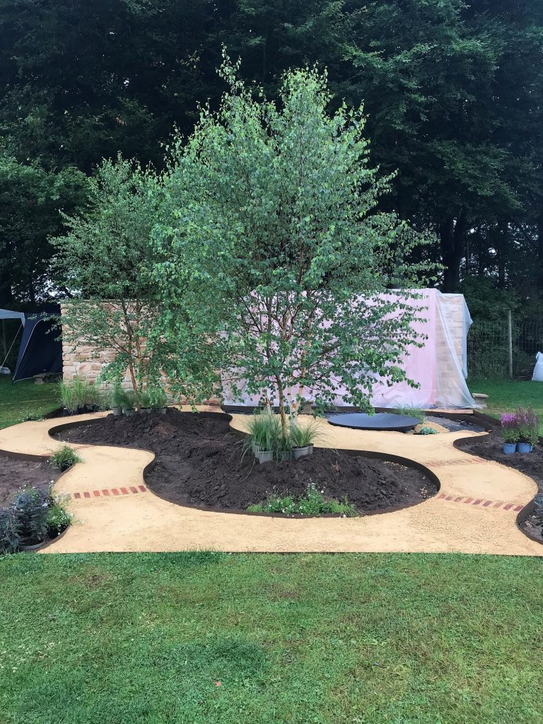 The Dreamscape Garden in progress with the Goldpath paths laid.