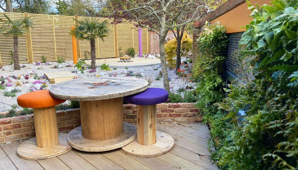 Wooden outside bar area and green living wall.