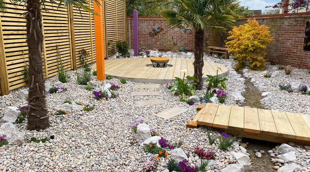 Overview of Club Tropicana garden with Scottish Pebbles and Cobbles and Longstone Rockery and water feature