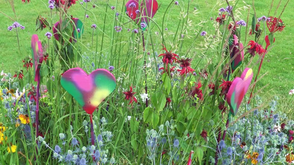 Colourful flowers with multi-coloured hearts within them
