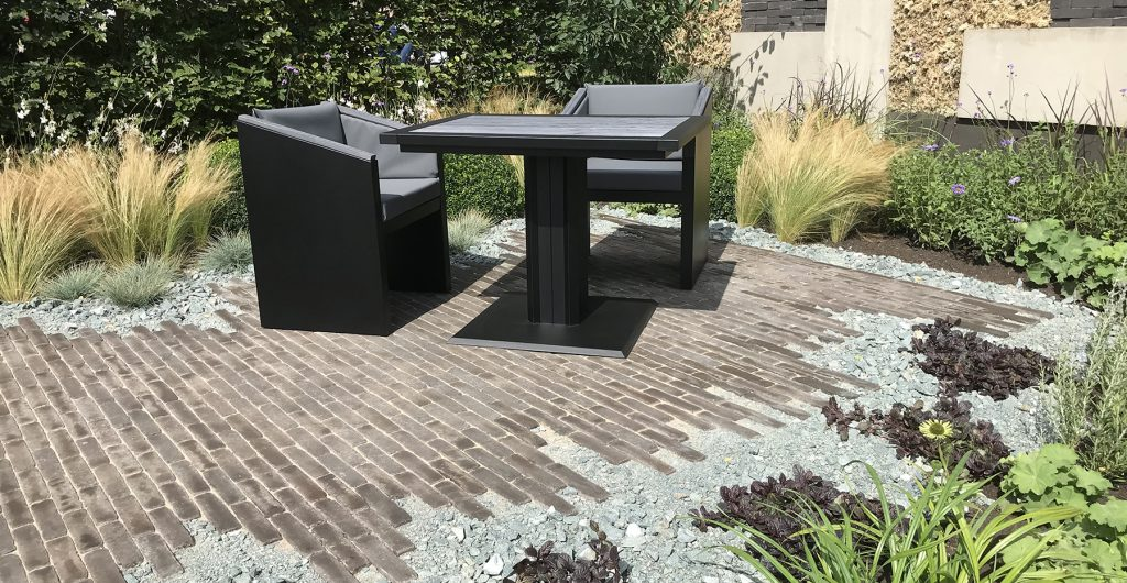 Shades of Grey garden with black seating area.
